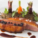Caramel-smoked duck breast with sweet spices, duck liver parfait, mango salad, Pedro Ximenez jelly, vanilla oil